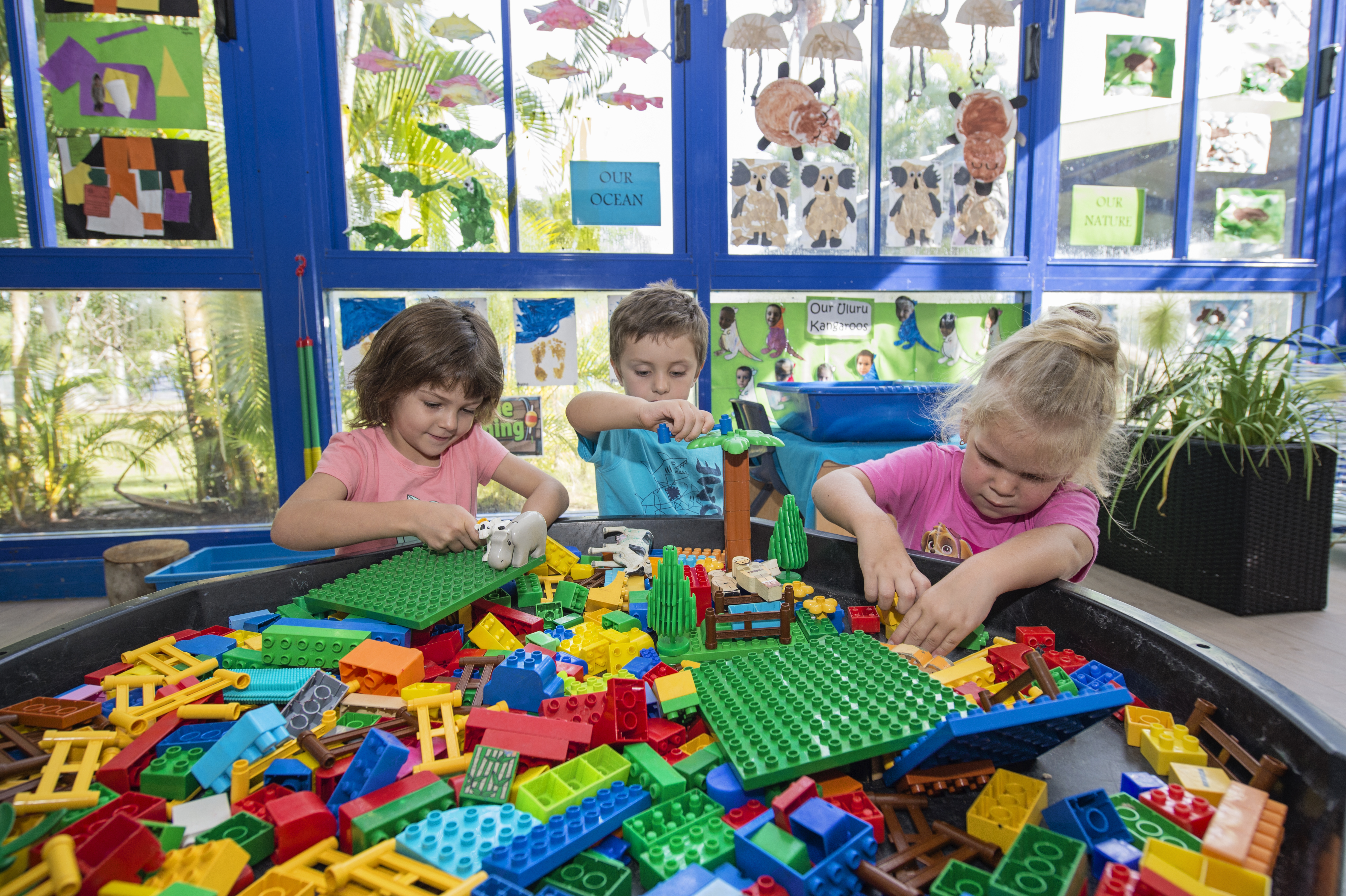 Group of children playing with Lego in classroom at Milestones Wagaman